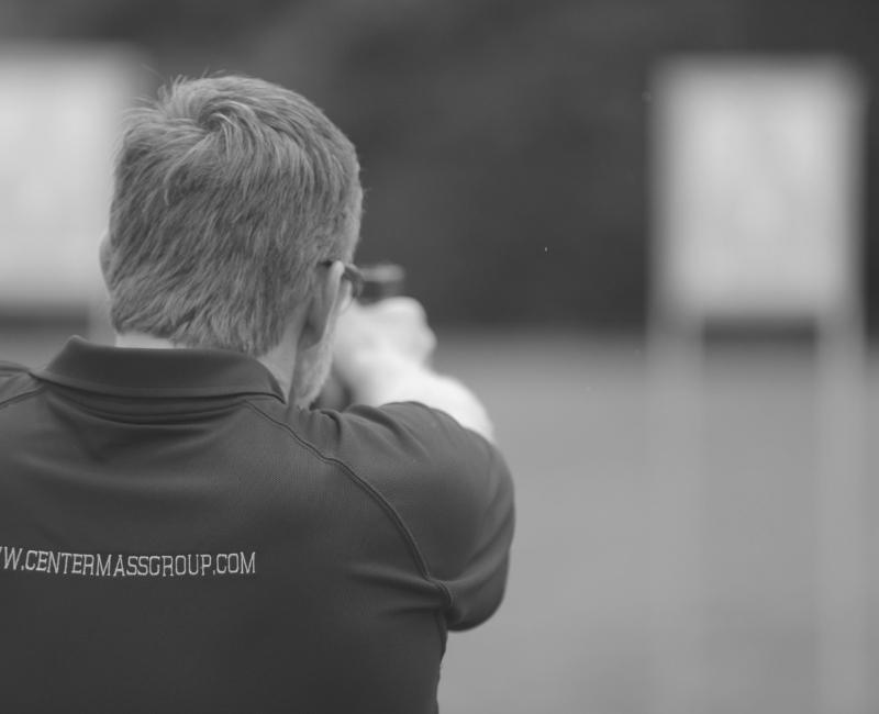 Chris Sajnog aiming a gun